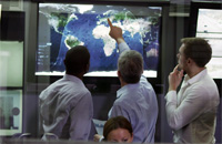 Men looking at map screen display - Digital Possible