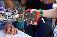 Robot hand with child- The Digital Possible